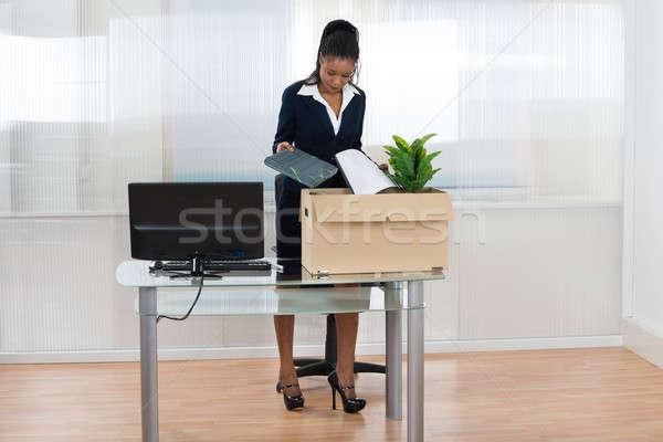 Stock photo: Businesswoman Putting Her Belongings In Box
