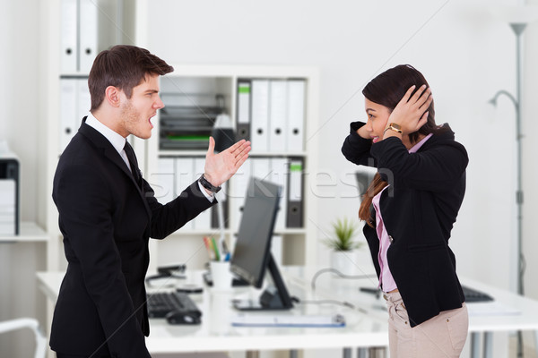 Boss Yelling At Secretary Covering Ears Stock photo © AndreyPopov