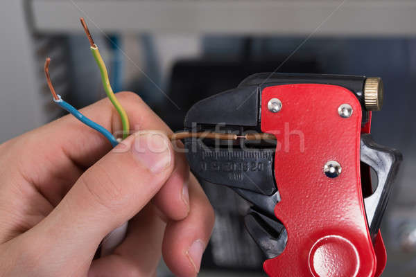 Electrician Hands Stripping Electrical Wires Stock photo © AndreyPopov
