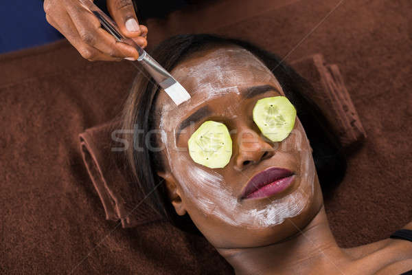 Woman Applying Facial Mask In Spa Stock photo © AndreyPopov