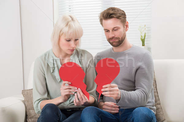 Couple Holding Red Broken Heart Stock photo © AndreyPopov