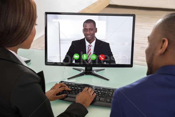 Businesspeople Having Videoconference Stock photo © AndreyPopov
