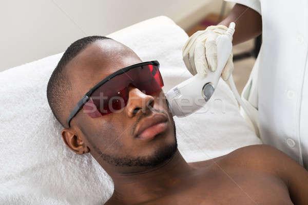 Terapeuta lézer epiláció kezelés fiatalember közelkép Stock fotó © AndreyPopov