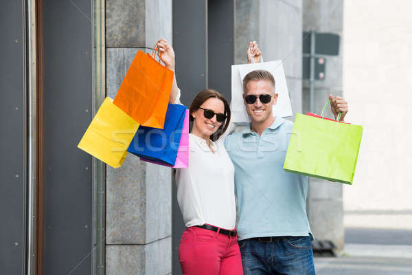 Couple Holding Multi-colored Shopping Bag Stock photo © AndreyPopov