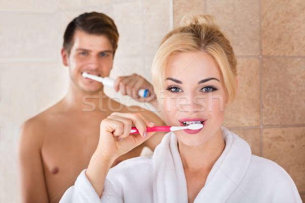 Portré férfi nő fogmosás fürdőszoba otthon Stock fotó © AndreyPopov