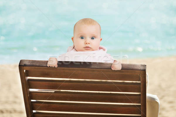 Baby Leaning On Deckchair On Beach Stock photo © AndreyPopov