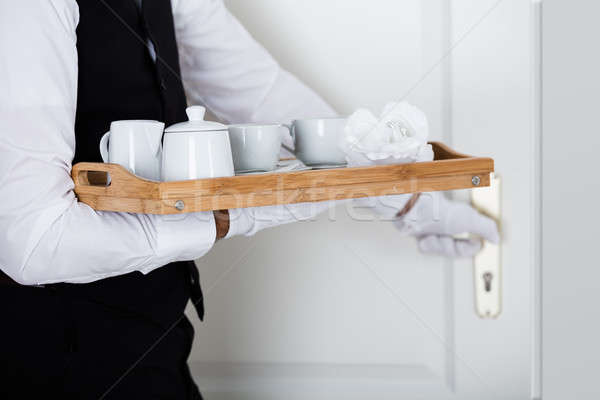 Man's Hand Holding Wooden Tray With Coffee Set Stock photo © AndreyPopov