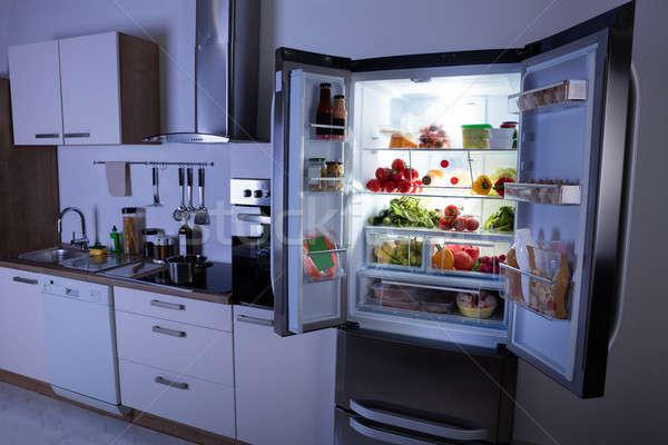 Open Refrigerator In Modern Kitchen Stock photo © AndreyPopov
