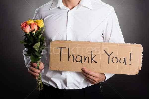 Homem rosas obrigado texto escrito Foto stock © AndreyPopov