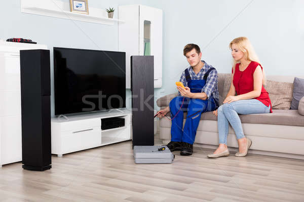 Male Technician Checking TV Speaker With Multimeter Stock photo © AndreyPopov