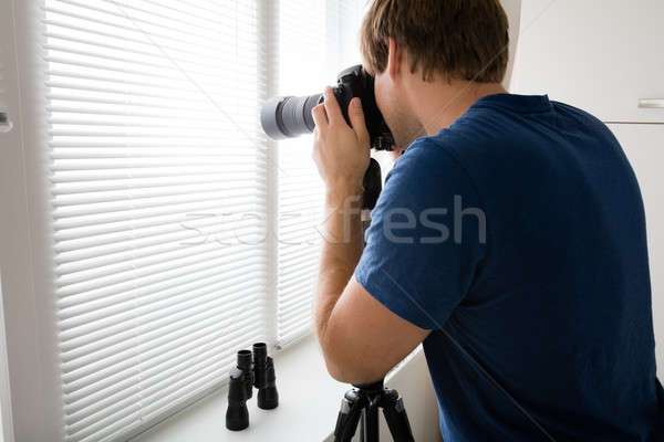 Male Holding Camera Photographing Stock photo © AndreyPopov