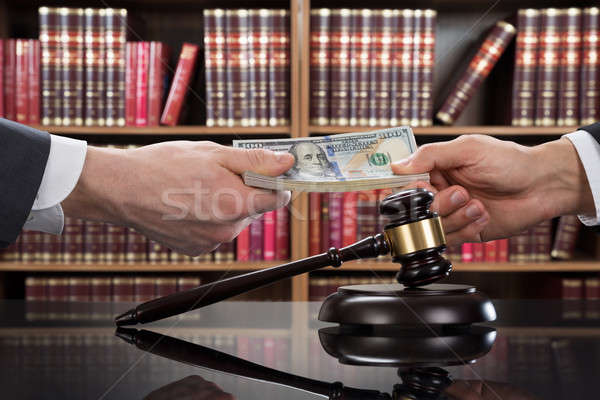 Gavel With Judge Taking Bribe From Client Stock photo © AndreyPopov