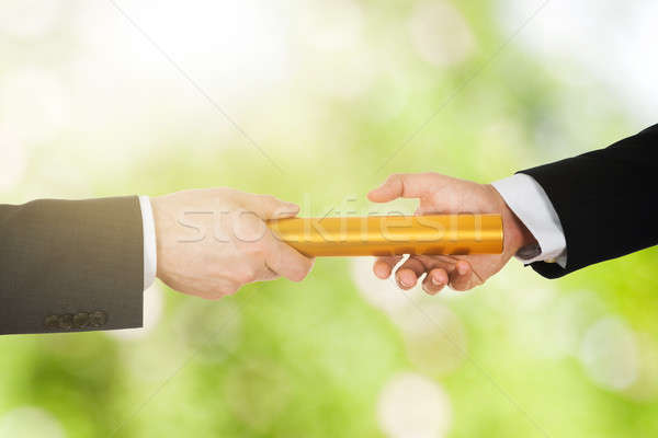 Two Businessman's Passing A Golden Relay Baton Stock photo © AndreyPopov