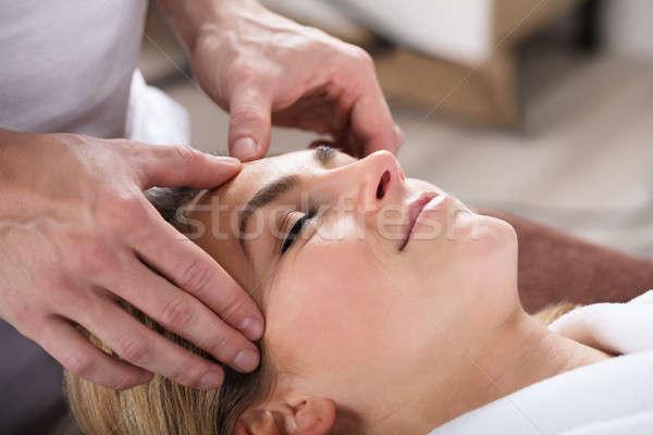 терапевт массаж лоб красивой Сток-фото © AndreyPopov