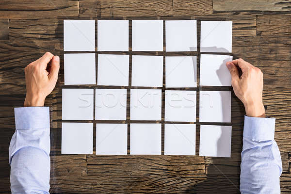 üzletember tapadó jegyzetek asztal közelkép kéz Stock fotó © AndreyPopov