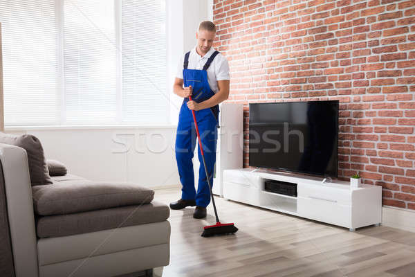 Male Janitor Sweeping Floor With Broom Stock photo © AndreyPopov