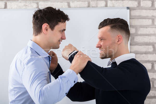 Close-up Of Businessman Fighting Stock photo © AndreyPopov