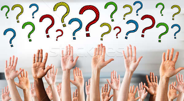 Multicolored Question Marks Above Business People's Hands Stock photo © AndreyPopov