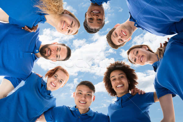 Smiling Multiracial Janitors Forming Huddle Stock photo © AndreyPopov