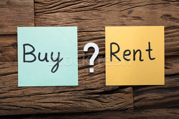Buy And Rent On Sticky Notes Amidst Question Mark Stock photo © AndreyPopov