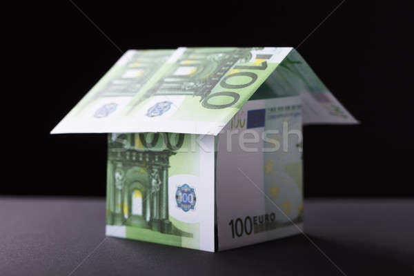 Ház felfelé bankjegy közelkép fekete papír Stock fotó © AndreyPopov
