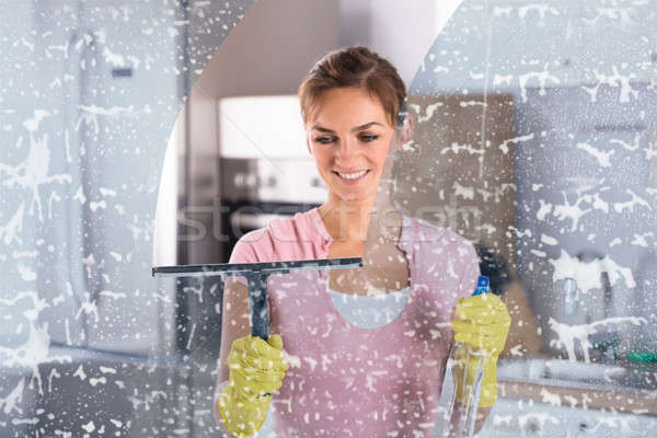 Woman Wearing Yellow Gloves Cleaning Window Stock photo © AndreyPopov