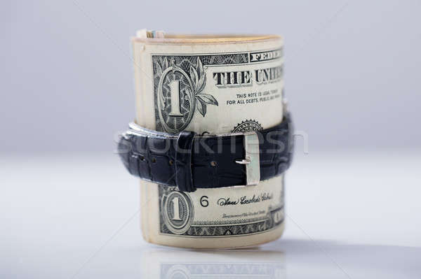 Rolled Up Dollar Banknotes Tied With Belt Stock photo © AndreyPopov