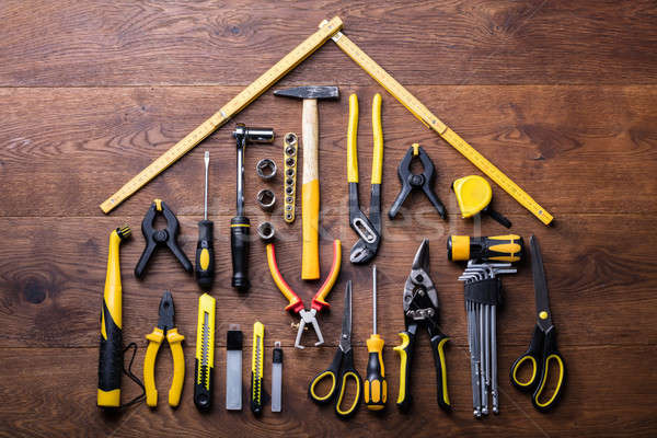 House Made Up Of Measuring Tapes And Tools Stock photo © AndreyPopov