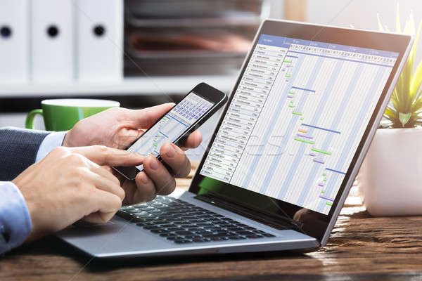 Businessperson Working With Gantt Chart On Mobile Phone Stock photo © AndreyPopov
