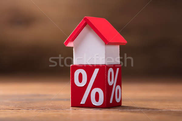 House Model And Percentage Red Block On Table Stock photo © AndreyPopov