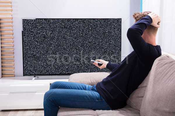 Man Looking At Television With No Signal Stock photo © AndreyPopov