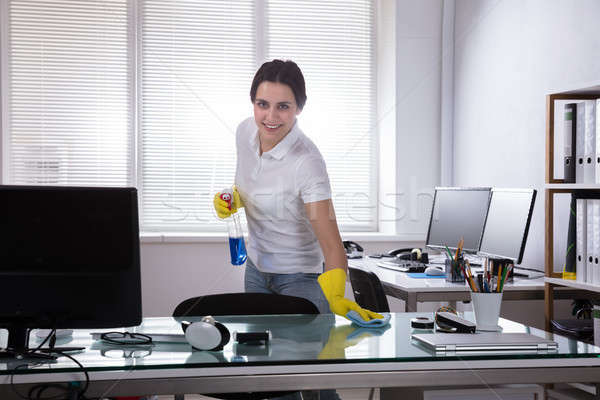 Janitor Cleaning Desk With Rag Stock photo © AndreyPopov