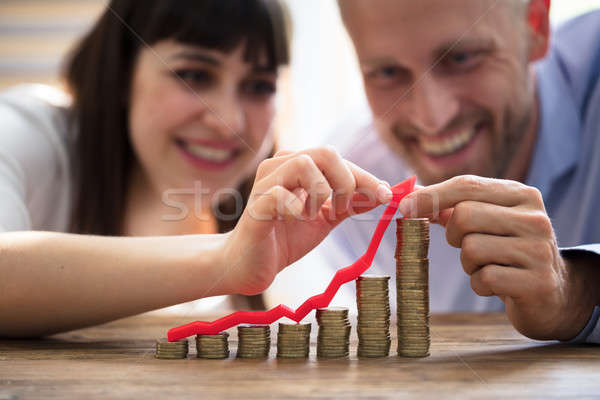 Couple Protecting Increasing Stacked Coins Stock photo © AndreyPopov