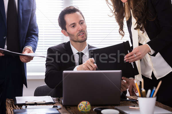 Stock photo: Young Businessman Looking At Document