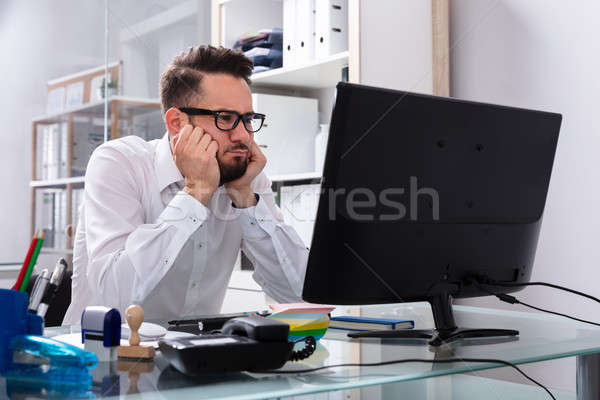 Stressed Businessman Sitting In Office Stock photo © AndreyPopov