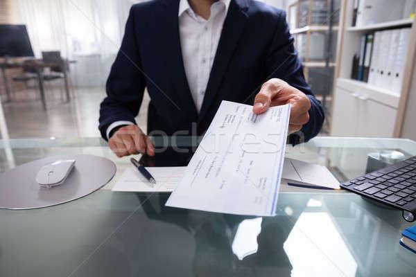 бизнесмен проверка стороны стекла столе человека Сток-фото © AndreyPopov