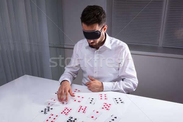 Bekötött szemű üzletember olvas kártyák iroda fehér Stock fotó © AndreyPopov