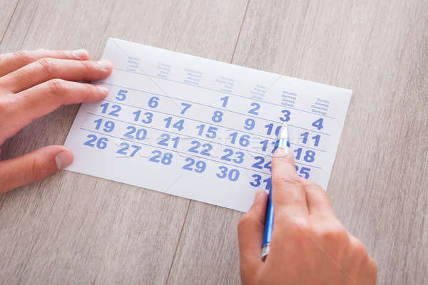 Hand Holding Calendar And Pen Stock photo © AndreyPopov