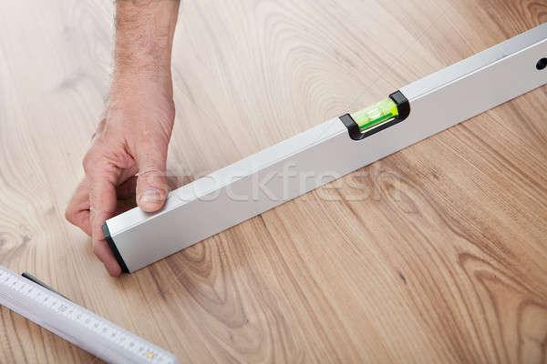 Worker working on laminate floor Stock photo © AndreyPopov