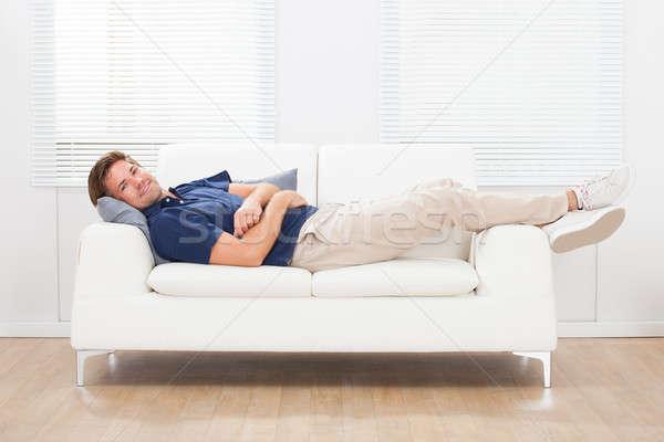 Man Lying On Sofa At Home Stock photo © AndreyPopov