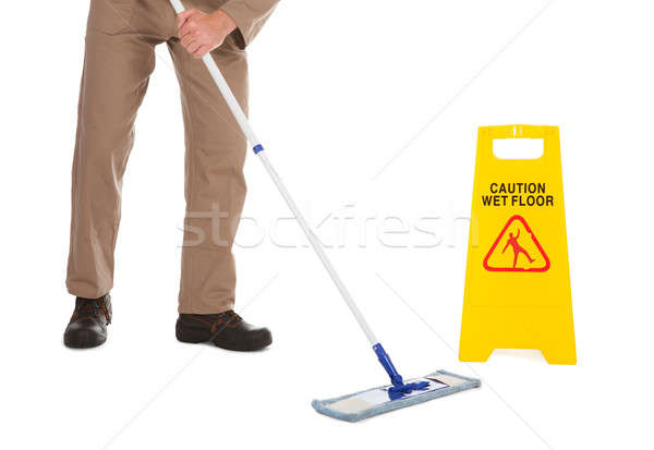 Servant Mopping Floor Over White Background Stock photo © AndreyPopov