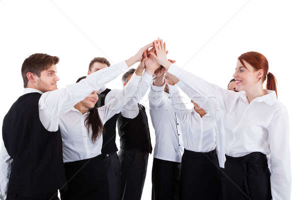 Catering staff making high five gesture Stock photo © AndreyPopov