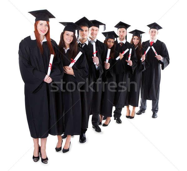 Mezun Öğrenciler ayakta yalıtılmış Stok fotoğraf © AndreyPopov