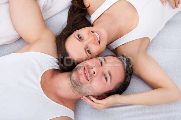 Happy Young Couple Lying On Back Stock photo © AndreyPopov