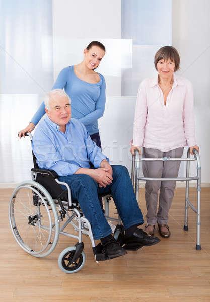 Stockfoto: Gehandicapten · verzorger · portret · vrouwelijke · verpleeginrichting