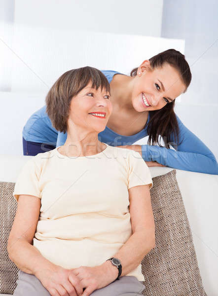 Portrait Of Happy Caregiver With Senior Woman Stock photo © AndreyPopov