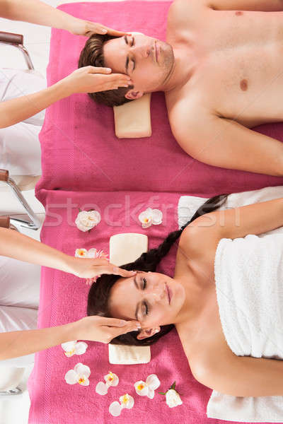 Relaxed Couple Receiving Head Massage At Beauty Spa Stock photo © AndreyPopov