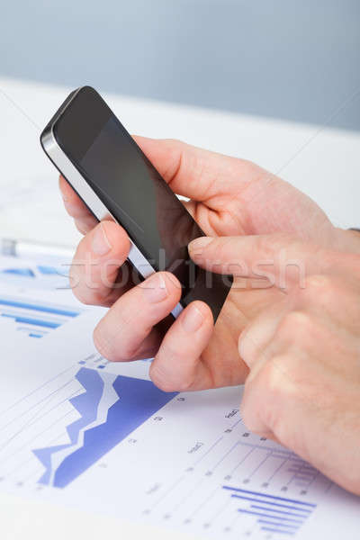 Person's Hand Using Cell Phone Stock photo © AndreyPopov