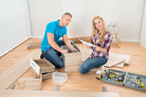 Couple Assembling Furniture Stock photo © AndreyPopov