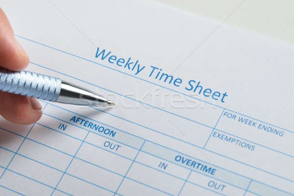 Person Hand With Pen Over Weekly Time Sheet Stock photo © AndreyPopov